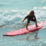child surfing at beach